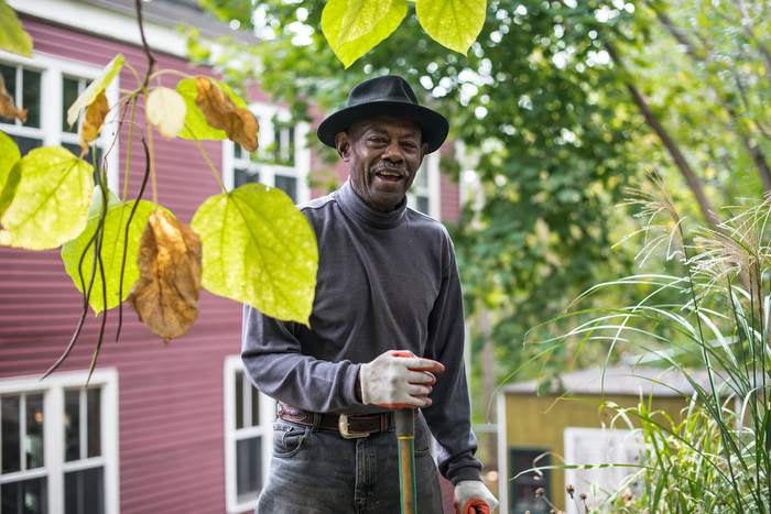 Willie Brown takes a break from his yardwork at his home in Roxbury.