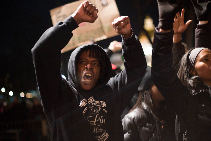 Boston. Dec. 4, 2014. Peter Brown, 50, from Boston, joins the protests against  a New York's grand jury decision to not indict Daniel Pantaleo, a white male police officer whose chokehold on Eric Garner, an unarmed black man,resulted in Garner's death.