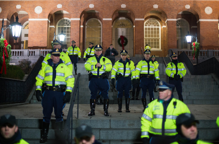 Boston. Dec. 4, 2014. Boston and State police stand behind the Massachusetts State House gates as hundreds gather outside demanding justice for Eric Garner, a black man who died of a chokehold by a white police officer in State Island in July.