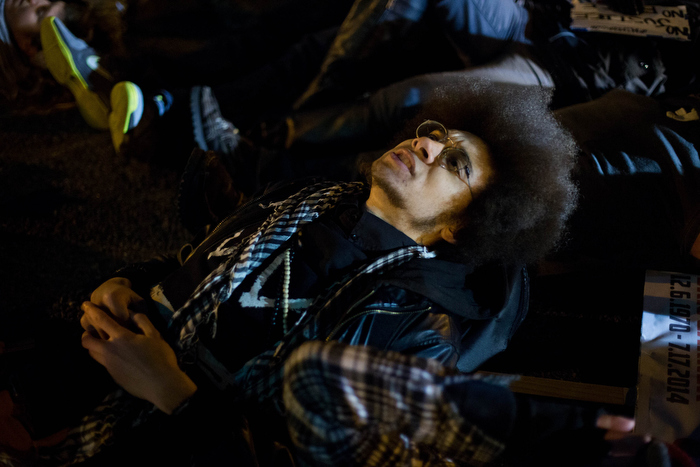 Boston. Dec. 4, 2014. A protestor joins others as they lie down on Boston streets and stop the traffic flow on Thursday night.