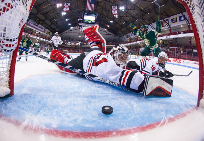 BOSTON, MA - OCTOBER 29: Jarrid Privitera #19 of the Vermont Catamounts celebrates his goal as Ryan Ruck #41 and John Stevens both of the Northeastern Huskies watch as the puck enters the net during NCAA hockey at Matthews Arena on October 29, 2015 in Boston, Massachusetts. The Catamounts won 3-2.
