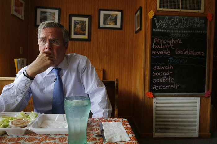 U.S. Republican presidential candidate Jeb Bush listens to a question during an interview with Reuters at Nonie's Restaurant in Peterborough, New Hampshire October 13, 2015.