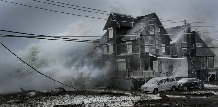 Waves pound ocean front homes in the Brant Rock section of Marshfield during a winter blizzard. Many homes were damaged or destroyed.