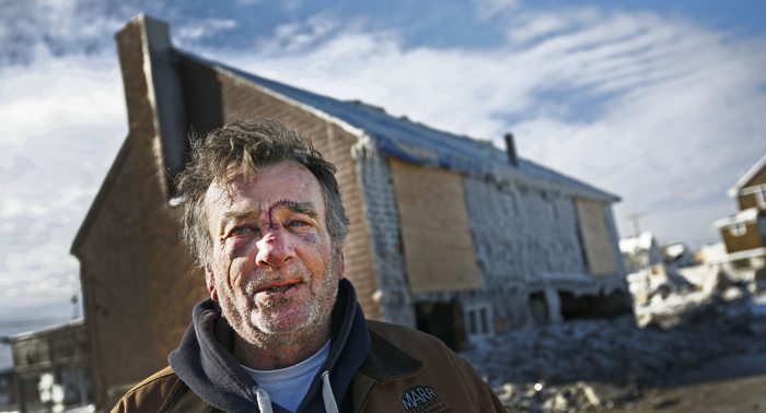 Brant Rock, Marshfield resident and commercial fisherman Tim Mannix talks about how he was injured in his home while trying to secure sliding doors during the height of a  blizzard. He received dozens of stitches and a broken nose when waves crashed through the doors. His home was severely damaged.