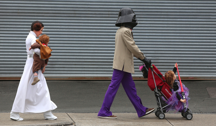 "After attending ""PRU BOO"" for trick-or-treating at The Shops at Prudential Center,"" the Morra family heads down Harrison Avenue to another venue.  Dad David is Darth Vader.  Mom Ronda is Princess Leia."