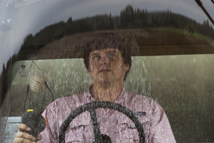 A partially picked field of cotton is reflected in the window of the cab of a picker operated by nineteen year-old Reese Foster at Lee Farm in Bronwood, Georgia October 27, 2015.  When Reese is not attending college, he works for Ronnie Lee, who farms 9,000 acres, of which about 5,500 acres are cotton.