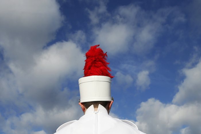 A member of the Bridgewater-Raynham marching band warmed up before the start of the Thanksgiving day high school football game between Brockton at Bridgewater-Raynham in Bridgewater, Massachusetts November 26, 2015.
