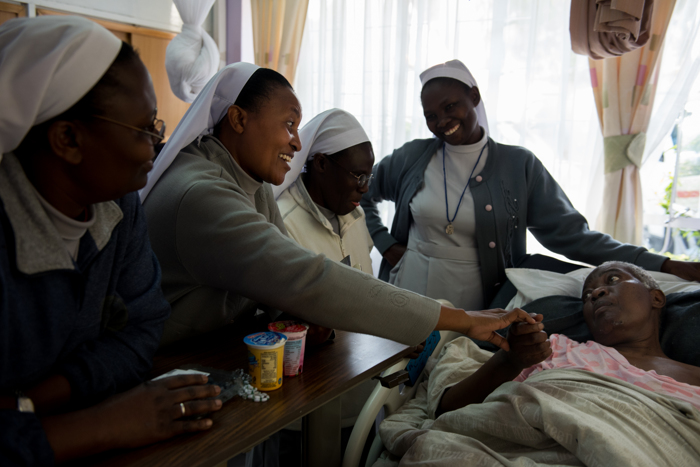 Sisters of Mary of Kakamaga gather to show support for Naliaka Odilia, their friend and fellow congregate of 50 years, who has a brain turmor on Saturday afternoon at the Texas Cancer Center in patient facility in Nairobi, Kenya on Saturday, Aug. 22, 2015. Nurses in this facility are trained in palliative care and give round the clock care to over a dozen patients in this small medical building, a privilege the majority of Kenyans don't have access to.