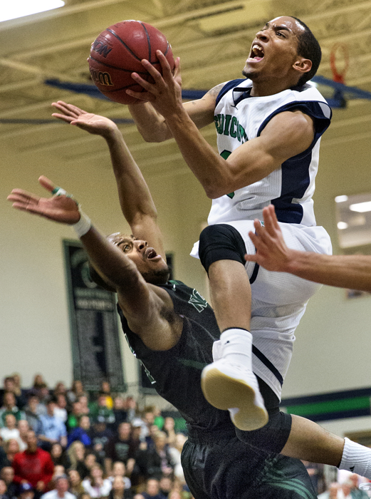 Endicott College guard Kamahl Walker goes in for a layup in a game against Nichols College, 2st-half action, Beverly, MA, 1/27/16. Endicott lost to Nichols by a final score 86-77.