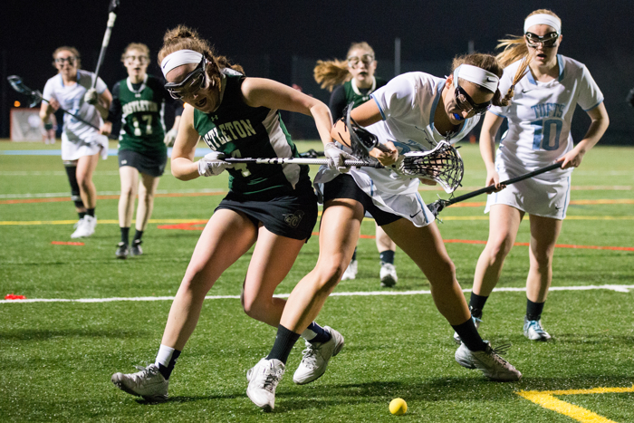 Midfielder Caroline Nowak fights to regain possession of the ball in the game against Castleton on Monday, March 7, 2016.
