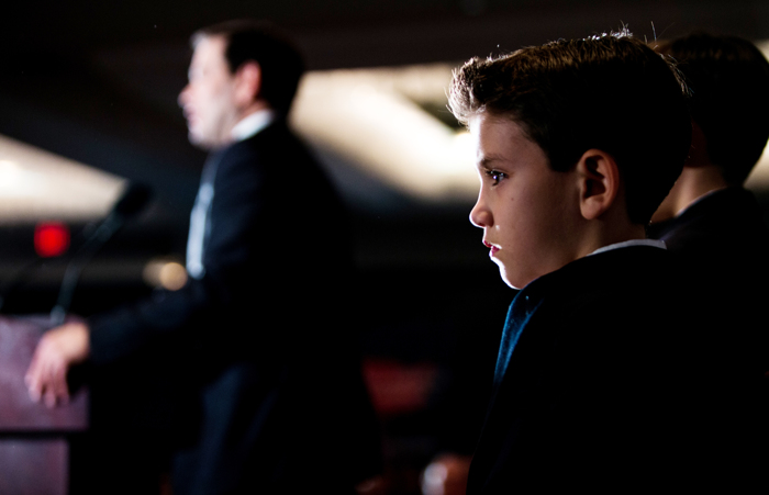 Feb. 9, 2016 - Sen. Marco Rubio's son Anthony Rubio stands on stage as his father speaks to hundreds of supporters at his New Hampshire Primary event at the Raddisson Hotel in Manchester.