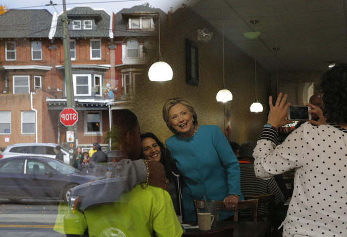 U.S. Democratic presidential nominee Hillary Clinton greets diners at Cedar Park Cafe in Philadelphia, Pennsylvania November 6, 2016.