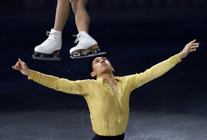 Pairs silver medalists Sui Wenjing and Han Cong skate during the exhibition program at the World Figure Skating Championships in Boston.