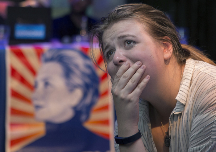 Nov. 9, 2016 – Shortly after 1 a.m. on Election Night 2016 Hillary Clinton supporter Marielle Riveros, 21, of Boston, reacts to presidential election results indicating a Trump victory at a viewing party at Club Café in Downtown Boston.