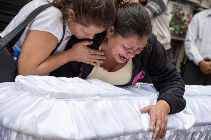 Mother of Rosa Julia Tobar cries over her daughter's coffin during funeral ceremony. Rosa was one of at least 40 girls killed in the Virgen de la Asunci—n fire in Guatemala City this past March.
