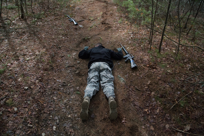 A Boston University ROTC student plays dead during a leadership field training exercise at Stonehill College on March 26, 2017.