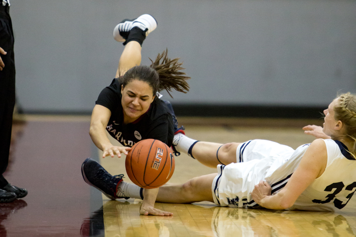 Katie Benzan (Harvard) falling after being tripped up in an Ivy League Conference matchup versus Yale. Harvard won the game 76-56.