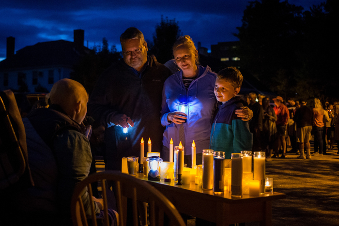 Penacook Elementary School fourth-grader Holden Turner, 9, of Penacook visits Chris Foley with his parents, Jeremy and Heather Turner, outside Concord Regional VNA's hospice house in Concord, N.H., on Friday, Sept. 8, 2017. The Turners, and many others, had come to place their candles and say hello Ð and goodbye Ð to Foley, an adored former principal of Penacook Elementary School. Foley was close to finishing his fourth year at the school when a seven-inch sarcoma tumor was discovered in his stomach in March. He died at age 39 surrounded by his family, including a newborn son, in late September.
