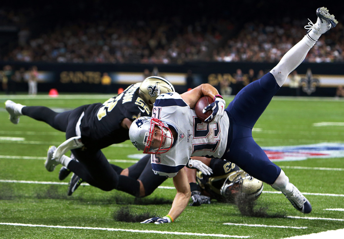 New Orleans, LA:  September 17, 2017: Patriots WR Chris Hogan is upended, but not before a third quarter catch of a Tom Brady pass. The New England Patriots visited the New Orleans Saints in a regular season NFL football game at the Mercedes-Benz Superdome.