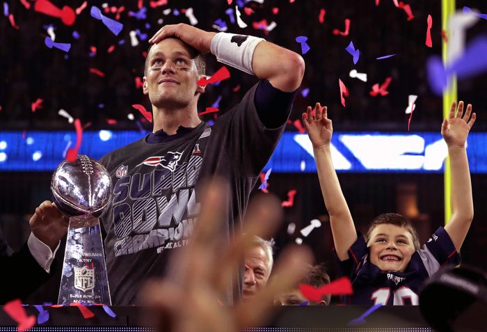 New England Patriots quarterback Tom Brady and son Benjamin celebrate with the Lombardi trophy after the Patriots defeated the Atlanta Falcons 34Ð28 in overtime after trailing 28Ð3 during the third quarter of Super Bowl LI at NRG Stadium in Houston. The Patriots' 25-point comeback is the largest comeback in Super Bowl history.