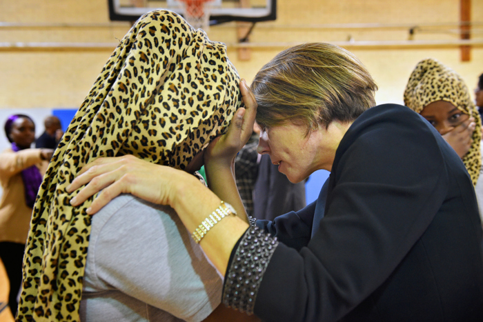 "(01/30/17 Dorchester, MA) Somalian twins, Muna and Muniira Abdi, 12 are reassured by Attorney General, Maura Healey they are protected as American citizens here in Boston. Maura Healey talks to  Muna as she starts to cry. The twins expressed their fear in recent events and asked Healey, "" What are you doing to make us feel like Americans too?""  during the announcement program of  a new youth anti-gun violence program with Boston Public School leaders and local officials at the Martin Luther King Jr k-8 Inclusion School.  January 30, 2017"