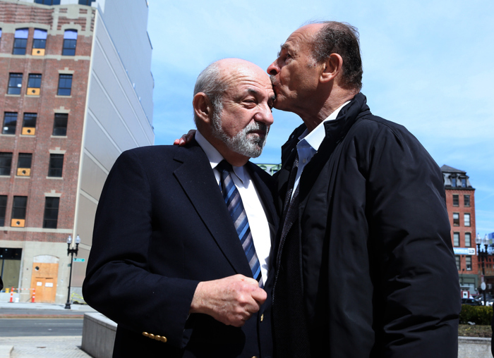 Suffolk County Register of Probate Felix D. Arroyo gets a kiss from supporter John B. Cruz III, president of Cruz Construction, following Arroyo's news conference regarding his suspension and subsequent investigation outside the Brooke Courthouse in Boston, Monday, April 3, 2017.