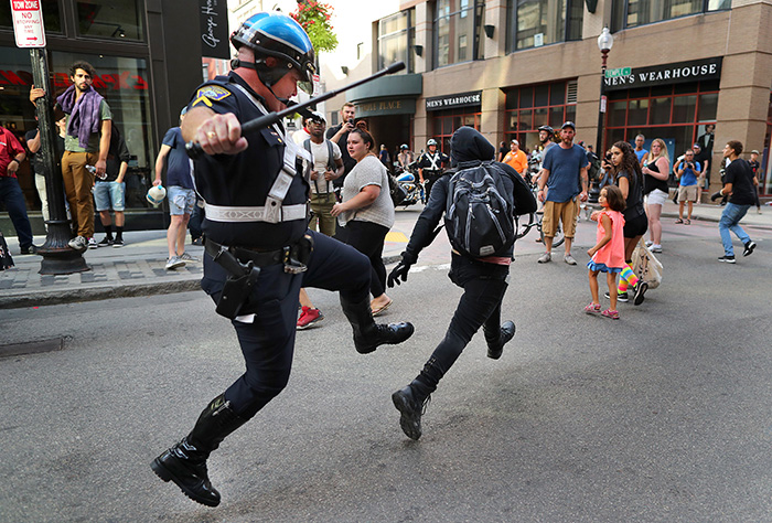 Boston-8/19/17  A Boston Police officer chases a protestor down Washington Street in Downtown Crossing with his baton out. He caught him and  the protestor was subdued and arrested. This, after a Free Speech rally was held on Boston Common. - Photo by John Tlumacki / The Boston Globe